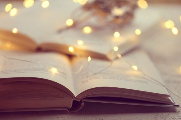 book with fairy lights in soft focus